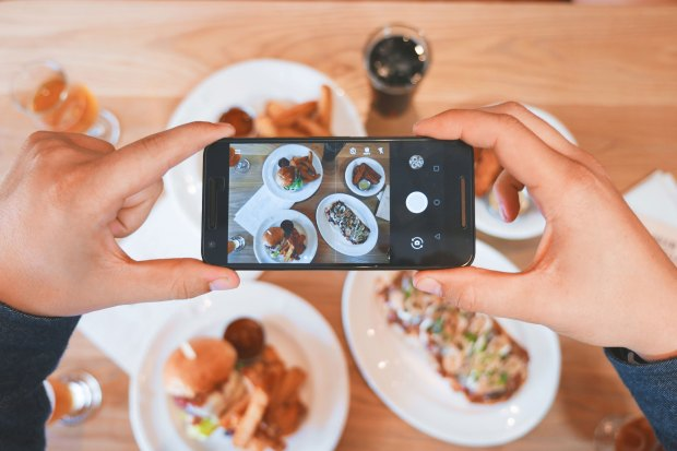 taking photos of food at a restaurant.jpg